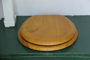 New oak toilet seat in outhouse